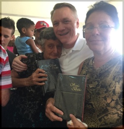 BroTim with lady and friend holding Bible.JPG